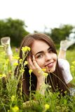 Beautiful girl in a meadow. The girl in the sunny morning in a meadow Royalty Free Stock Image