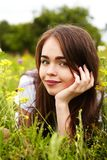 Beautiful girl in a meadow. The girl in the sunny morning in a meadow Stock Image