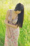 Beautiful girl on the meadow on sunny spring day.  royalty free stock photography