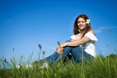 Beautiful girl in meadow Stock Images