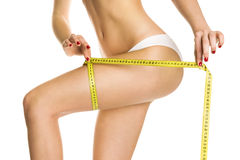Beautiful girl measure body. On a white background, isolated Royalty Free Stock Image