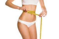 Beautiful girl measure body Stock Photography