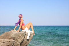 Beautiful girl meditating on the beach royalty free stock photo