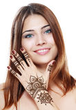 Beautiful girl with mehandi. Beautiful girl happy smiling have painted Mehandi fresh applied henna on her hand Stock Images