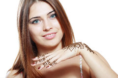 Beautiful girl with mehandi. Beautiful girl happy smiling have painted Mehandi fresh applied henna on her hand Royalty Free Stock Photos