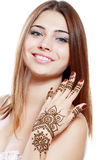 Beautiful girl with mehandi. Beautiful girl happy smiling have painted Mehandi fresh applied henna on her hand Royalty Free Stock Photo