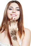 Beautiful girl with mehandi. Beautiful girl happy smiling have painted Mehandi fresh applied henna on her hand Stock Photography