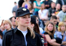 Beautiful girl, a member of the patrol police on the streets of the city. Royalty Free Stock Photos