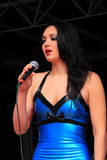 Beautiful girl microphone singing stock photography