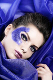 Beautiful girl in the middle of purple fabric Stock Images