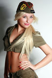 Beautiful girl in military clothes Royalty Free Stock Photography