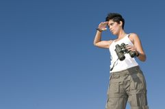 Beautiful girl in military clothes and binoculars Stock Photos