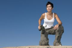Beautiful girl in military clothes and binoculars Royalty Free Stock Photography