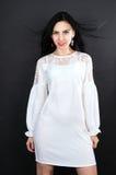 Beautiful girl in a mini dress posing Stock Images