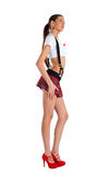 Beautiful girl in mini-skirt. Young pretty woman in white top and red mini skirt Stock Photography