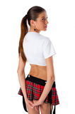 Beautiful girl in mini-skirt. Young pretty woman in white top and red mini skirt Royalty Free Stock Image