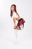 Beautiful girl in mini-skirt. Young pretty woman in top, red mini skirt and white boots Royalty Free Stock Images