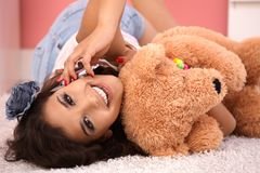 Beautiful girl on mobile hugging teddy bear Stock Photos