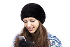 Beautiful girl with mobile phone. On a white background stock photography