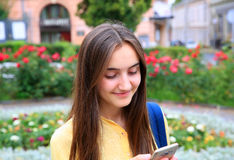 Beautiful girl with mobile phone reads a message Stock Image