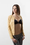 Beautiful girl model in beige jacket Royalty Free Stock Images