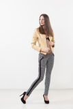 Beautiful girl model in beige jacket Stock Photos
