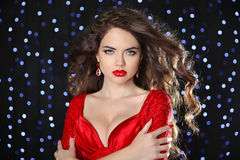 Beautiful girl model with long brown curled hair and hot lips we Royalty Free Stock Images