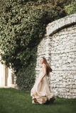 Beautiful girl, model with long hair posing in park near great wall. Krakow Vavel Stock Photos