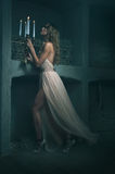 Beautiful girl model looks in the dress Stock Photos
