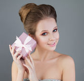 Beautiful Girl Model and Pink Gift. Young Perfect Woman Stock Photo