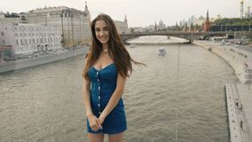 Beautiful girl model stand bridge river look at camera and sweet smile from 4K stock video footage