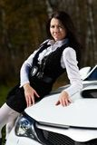 Beautiful girl model and stylish white sports car Royalty Free Stock Photography