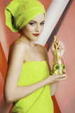 Beautiful girl model with water. Beautiful girl model holding drinking fresh water, in green towels, with lemon and mint , yellow straw, hydration is good for royalty free stock photography