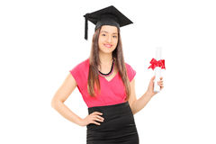Beautiful girl with mortarboard holding a diploma Royalty Free Stock Photography