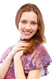 Beautiful girl in motley dress smiles Stock Images