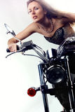 Beautiful girl on a motorbike. Stock Images