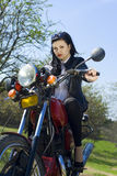 The beautiful girl on a motorcycle. On the nature Stock Image