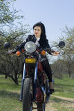The beautiful girl on a motorcycle. On the nature Stock Images