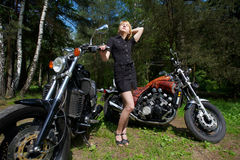 Beautiful girl and motorcycle Royalty Free Stock Photography