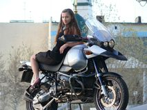 Beautiful girl on a motorcycle. Royalty Free Stock Photos