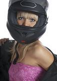 The beautiful girl with a motorcycle helmet Stock Image