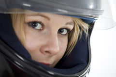 Beautiful girl in a motorcycle helmet Stock Image