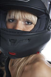 The beautiful girl with a motorcycle helmet Royalty Free Stock Photo