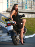Beautiful girl on a motorcycle. Royalty Free Stock Image