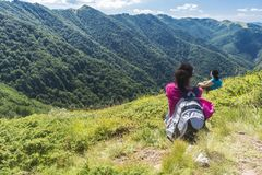 Beautiful girl in the mountains. An incredible view of the Troyan Balkan. The mountain captivates with its beauty, fresh air, a. Sense of infinity, coziness and royalty free stock photography