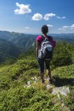Beautiful girl in the mountains. An incredible view of the Troyan Balkan. The mountain captivates with its beauty, fresh air, a. Sense of infinity, coziness and royalty free stock images