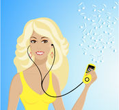 Beautiful girl with Mp3-player listening the music. Beautiful blonde girl with Mp3 player and headphones  listening the music Royalty Free Stock Image