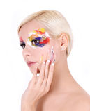 Beautiful girl with multicolored art makeup Royalty Free Stock Image