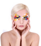 Beautiful girl with multicolored art makeup Royalty Free Stock Images