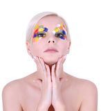 Beautiful girl with multicolored art makeup Stock Images